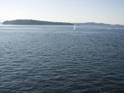 Sailboat on the Puget Sound Passes Blake Island, Washington State, United States of America