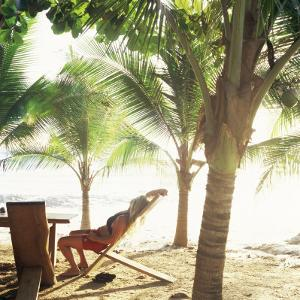 Young Woman Relaxes on Avellans Beach, Costa Rica, Central America by Aaron McCoy
