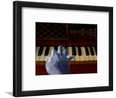Ghost Hand Playing the Piano