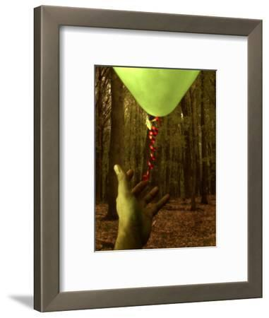 Hand Reaching for Balloon in Forest