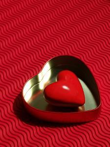 Heart Shaped Box Containing a Love Stone with Strong Red Background by Abdul Kadir Audah