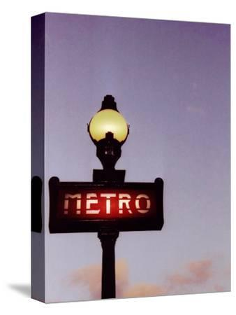 Metro Stop in Paris Against Sunset Sky