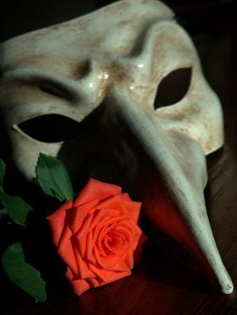 Still Life Photograph, a Traditional Venetian Mask with a Rose