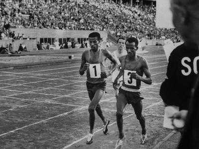 Abebe Bikila and Mamo Wolde in Exhibition Race at Berlin Olympic Stadium--Premium Photographic Print