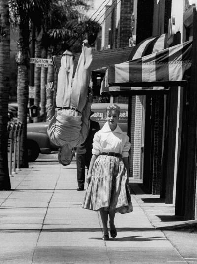 Acrobat and Actor, Russ Tamblyn Doing a Flip on the Sidewalk with Starlet Venetia Stevenson-Allan Grant-Premium Photographic Print