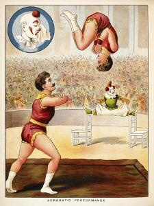 Acrobatic Performance'. Acrobats and a Clown Performing in the Circus Ring
