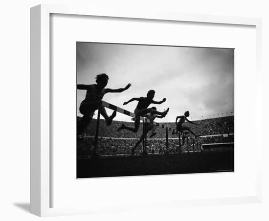 Action During the Women's 100m Hurdles at the 1952 Olympic Games in Helsinki-Mark Kauffman-Framed Photographic Print