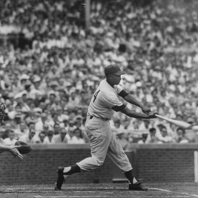 Action Shot of Chicago Cub's Ernie Banks Smacking the Pitched Baseball-John Dominis-Premium Photographic Print
