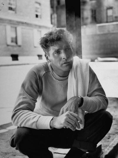 Actor Burt Lancaster, While Smoking Cigarette in Courtyard of Union Settlement House in E. Harlem-Robert Wheeler-Premium Photographic Print