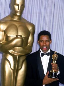 Actor Denzel Washington Holding His Oscar in Press Room at Academy Awards