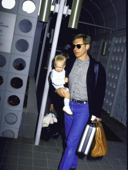 Actor Harrison Ford, Wearing Sunglasses, Holding Son Malcolm Premium  Photographic Print by | Art com