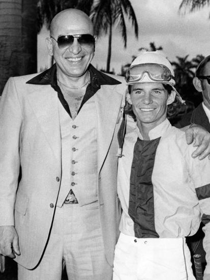Actor Telly Savalas Poses with a Jockey at Hialeah Park, C.1970--Photographic Print