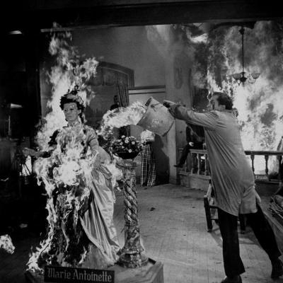 """Actor Vincent Price Putting Out Fire in Film """"House of Wax""""-J^ R^ Eyerman-Premium Photographic Print"""