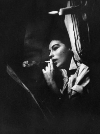 """Actress Ava Gardner Smoking a Cigarette in a Scene from the Film """"Mogambo""""-Peter Stackpole-Premium Photographic Print"""