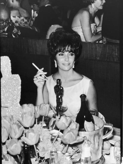Actress Elizabeth Taylor at Hollywood Party After Winning Oscar, Which is on Table in Front of Her-Allan Grant-Premium Photographic Print