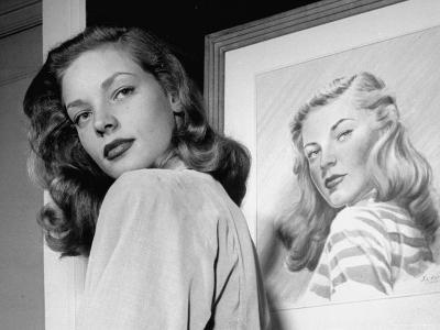 Actress Lauren Bacall Posing in Front of Portrait Drawing of Herself in Suite at the Gotham Hotel-Nina Leen-Premium Photographic Print