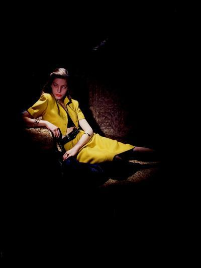 Actress Lauren Bacall Wearing Yellow Bare-Midriff Suit with Black Halter from B. H. Wragge-John Rawlings-Premium Giclee Print