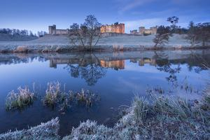 Alnwick Castle Reflected in the River Aln on a Frosty Winter Morning, Northumberland, England by Adam Burton