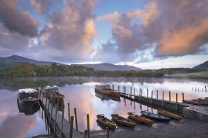 Boats on Derwent Water at Sunrise, Keswick, Lake District, Cumbria, England. Autumn (October) by Adam Burton