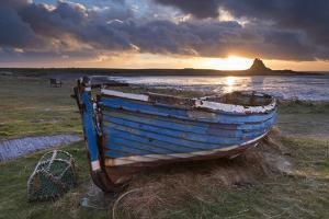 Decaying Fishing Boat on Holy Island at Dawn, with Lindisfarne Castle Beyond, Northumberland by Adam Burton