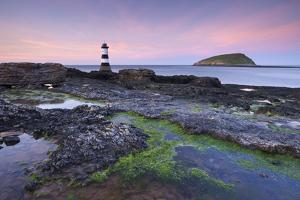 Dusk over Penmon Point Lighthouse and Puffin Island, Isle of Anglesey, Wales, UK. Spring by Adam Burton