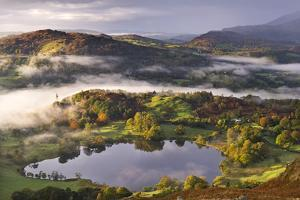 Loughrigg Tarn Surrounded by Misty Autumnal Countryside, Lake District, Cumbria by Adam Burton
