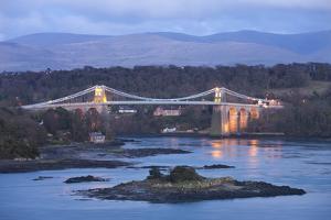 Menai Bridge Spanning the Menai Strait, Backed by the Mountains of Snowdonia National Park, Wales by Adam Burton