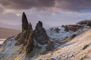 Snow dusted Old Man of Storr at sunrise, Isle of Skye, Scotland. Winter (December) 2013 by Adam Burton