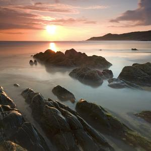 Sunset on Barricane Beach, Woolacombe, Devon, England. Summer by Adam Burton