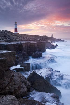 Waves Crash Against the Limestone Ledges Near the Lighthouse at Portland Bill, Dorset, England