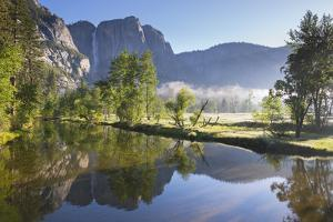 Yosemite Falls and the Merced River at dawn on a misty Spring morning, Yosemite Valley, California, by Adam Burton