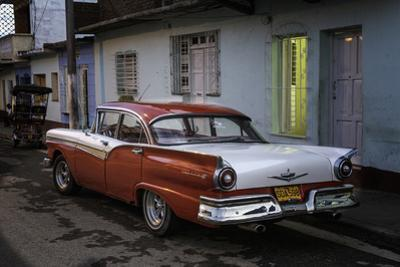 1950's Era Ford Fairlane and Colorful Buildings, Trinidad, Cuba
