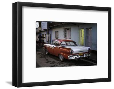 1950's Era Ford Fairlane and Colorful Buildings, Trinidad, Cuba