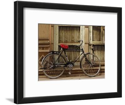 Bicycle in narrow gully, Delhi, India