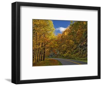 Blue Ridge Parkway Curving Through Autumn Colors Near Grandfather Mountain, North Carolina, USA
