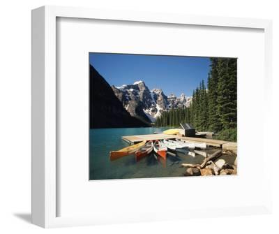 Canoe Moored at Dock on Moraine Lake, Banff NP, Alberta, Canada