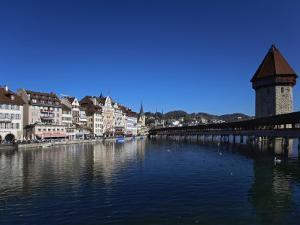 Chapel Bridge, Reuss River, Lucerne, Switerland by Adam Jones