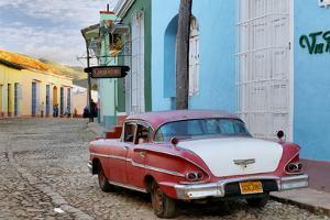 Colorful Buildings and 1958 Chevrolet Biscayne, Trinidad, Cuba by Adam Jones