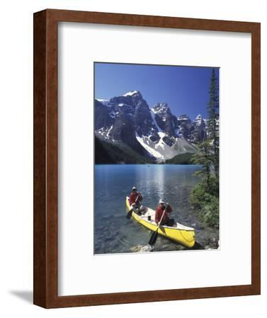 Couple Canoeing on Moraine Lake, Banff National Park, Alberta, Canada