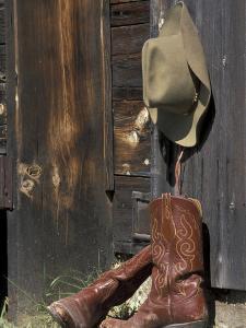 Cowboy Boots and Hat, Montana, USA by Adam Jones