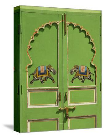 Elephants painted on green door, City Palace, Udaipur, India