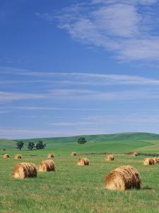 Farm Hay Bales and Clouds, Eastern Washington, USA by Adam Jones