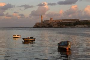 Fishing Boats and El Morro Lighthouse at Sunrise by Adam Jones