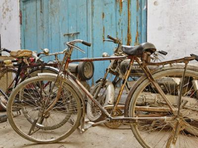 Group of bicycles in gulley (alley) Delhi, India