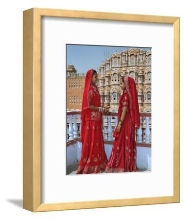 Indian women in color saris, Palace of the Wind, Jaipur, India