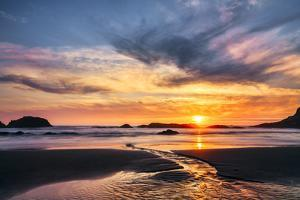 Small stream flowing across beach at sunset, Seal Rocks State Park, Oregon by Adam Jones