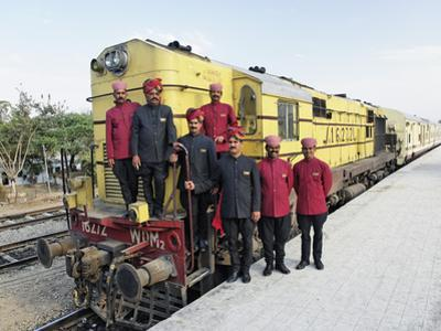 Staff Members for the Palace on Wheels Train Posing with the Train, Udaipur, India