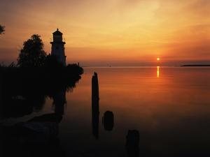 View of Sea and Lighthouse at Sunset, Cheboygan, Michigan, USA by Adam Jones