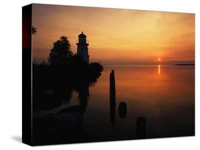 View of Sea and Lighthouse at Sunset, Cheboygan, Michigan, USA