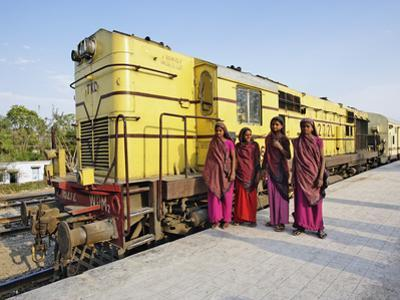 Young Indian Women Posing in Front of Palace on Wheels Train Parked at Train Station, Udaipur